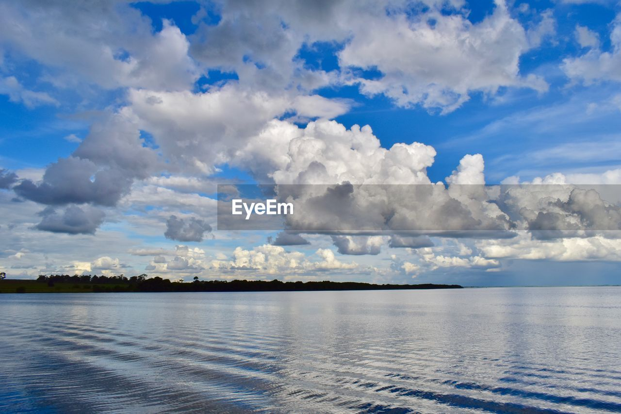 cloud - sky, sky, beauty in nature, scenics - nature, tranquility, water, tranquil scene, no people, waterfront, nature, day, idyllic, non-urban scene, sea, reflection, outdoors, blue, beach