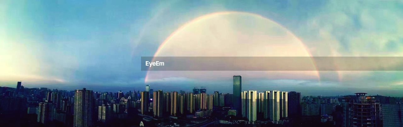building exterior, skyscraper, cityscape, architecture, city, rainbow, double rainbow, built structure, urban skyline, outdoors, cloud - sky, skyline, city life, downtown district, no people, travel destinations, sky, modern, day, nature, beauty in nature