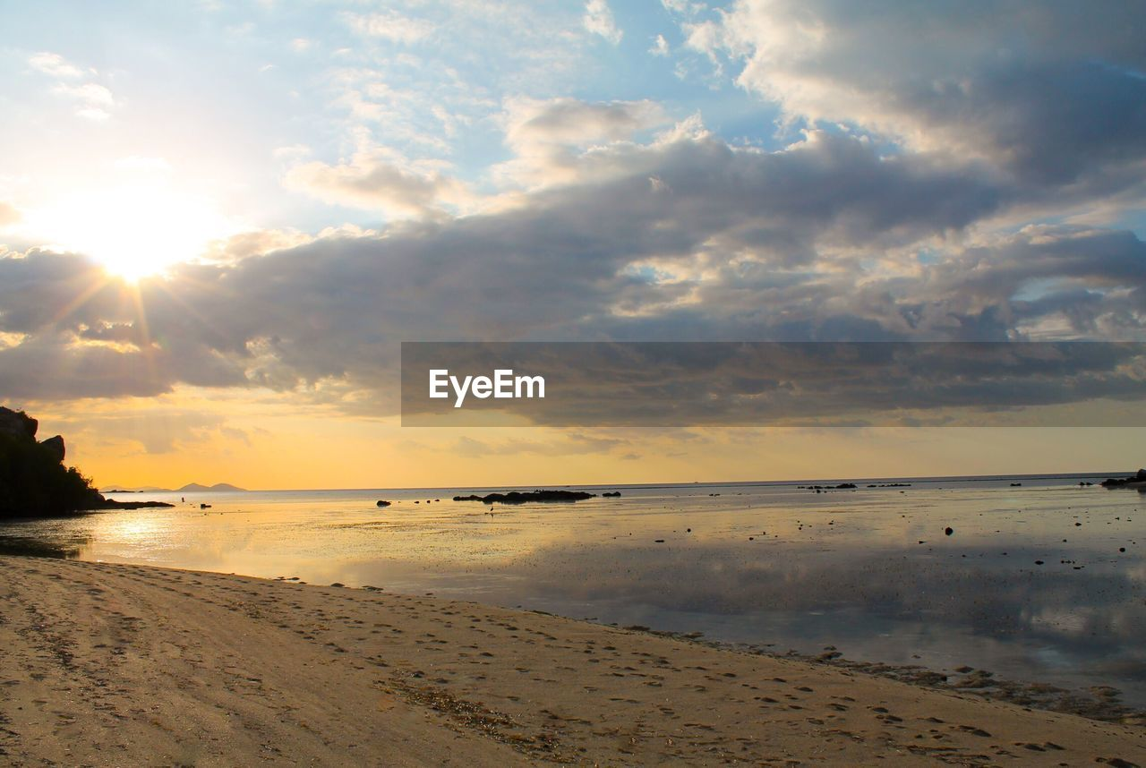 beach, sea, sand, water, nature, scenics, sunset, shore, sky, tranquility, beauty in nature, tranquil scene, cloud - sky, horizon over water, outdoors, sun, sunlight, no people, day