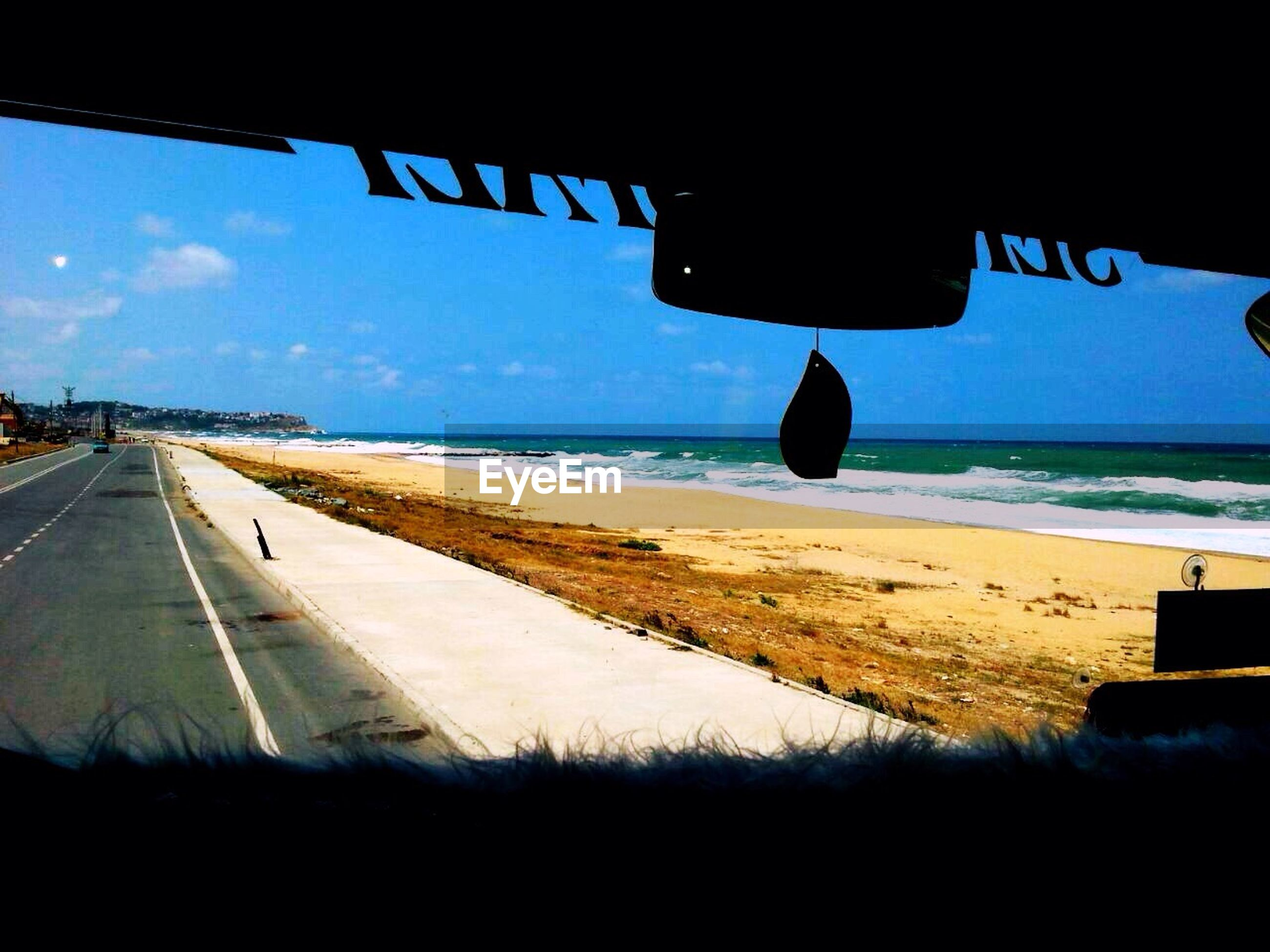 transportation, sea, horizon over water, mode of transport, sky, vehicle interior, water, car, travel, blue, beach, land vehicle, airplane, road, on the move, nature, journey, flying, scenics, window
