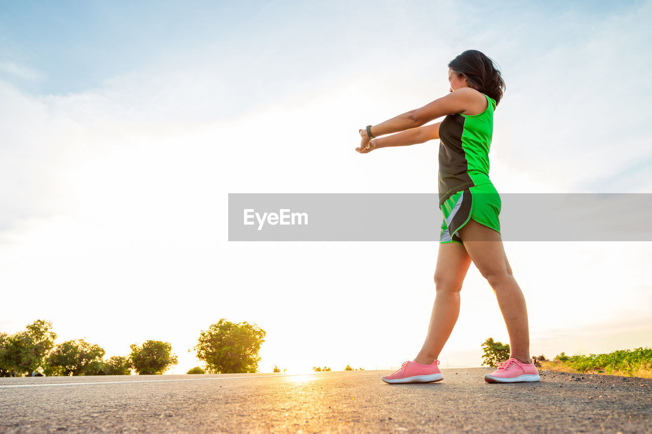full length, one person, sky, lifestyles, childhood, child, standing, real people, leisure activity, nature, females, women, casual clothing, sport, day, running, land, girls, sports clothing, shorts, outdoors