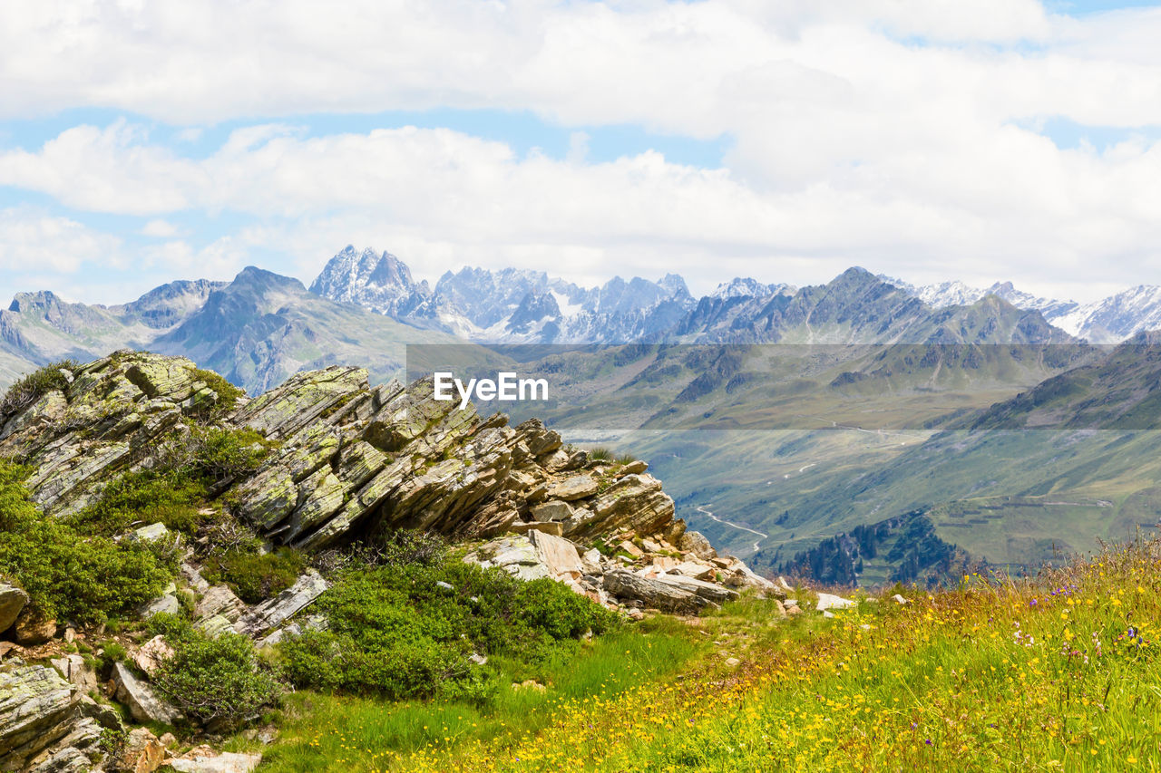 mountain, beauty in nature, sky, cloud - sky, landscape, environment, scenics - nature, plant, nature, tranquil scene, mountain range, day, no people, tranquility, wilderness, non-urban scene, idyllic, growth, green color, land, outdoors, mountain peak, range, snowcapped mountain