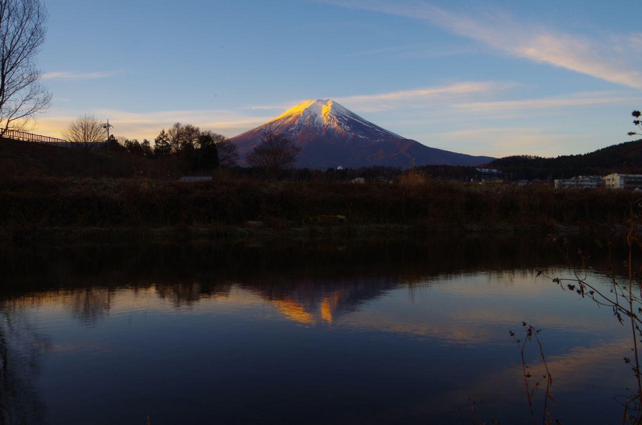 Scenic view of lake against mt fuji during sunrise