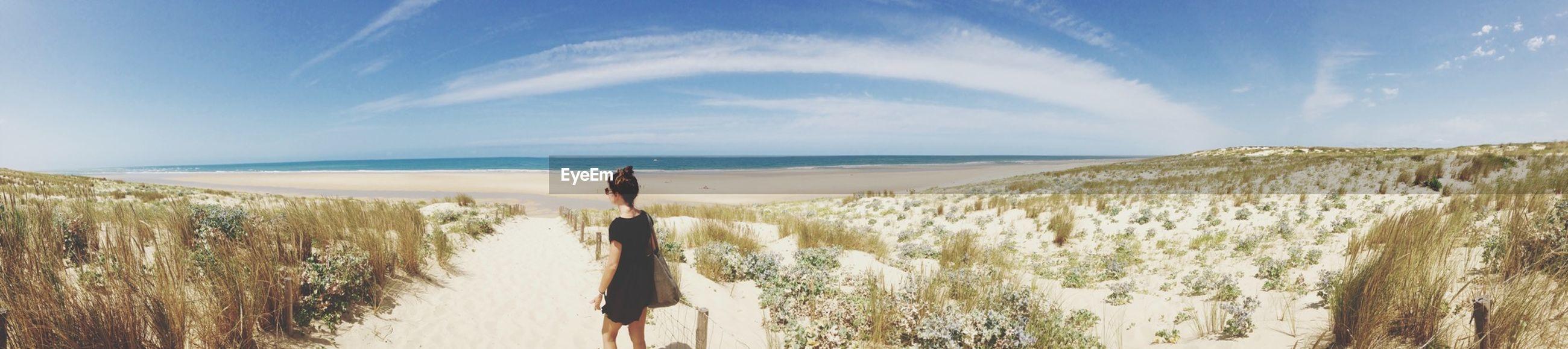 sea, horizon over water, water, beach, sky, tranquil scene, tranquility, scenics, beauty in nature, shore, nature, sand, idyllic, blue, grass, cloud, cloud - sky, remote, coastline, calm
