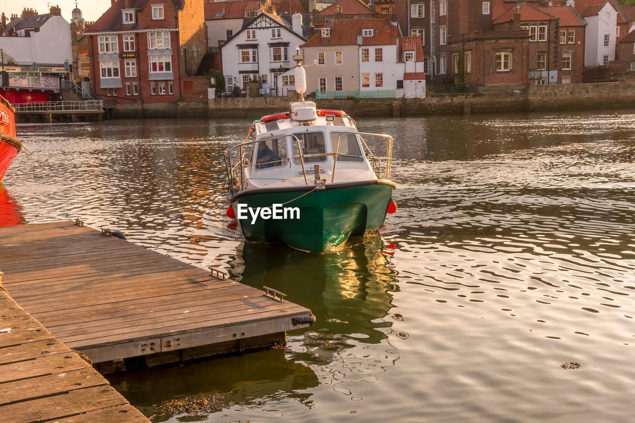 water, nautical vessel, transportation, mode of transportation, architecture, building exterior, built structure, waterfront, moored, nature, day, city, building, reflection, outdoors, sea, no people, inflatable
