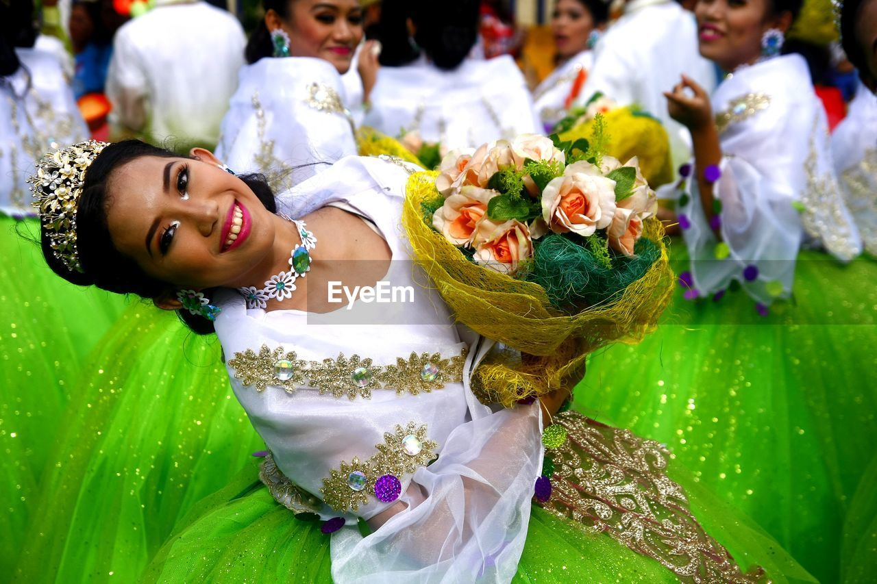 women, real people, traditional clothing, flower, flowering plant, celebration, incidental people, wedding, ceremony, event, females, lifestyles, one person, life events, newlywed, wedding ceremony, belief, bouquet, flower arrangement, outdoors
