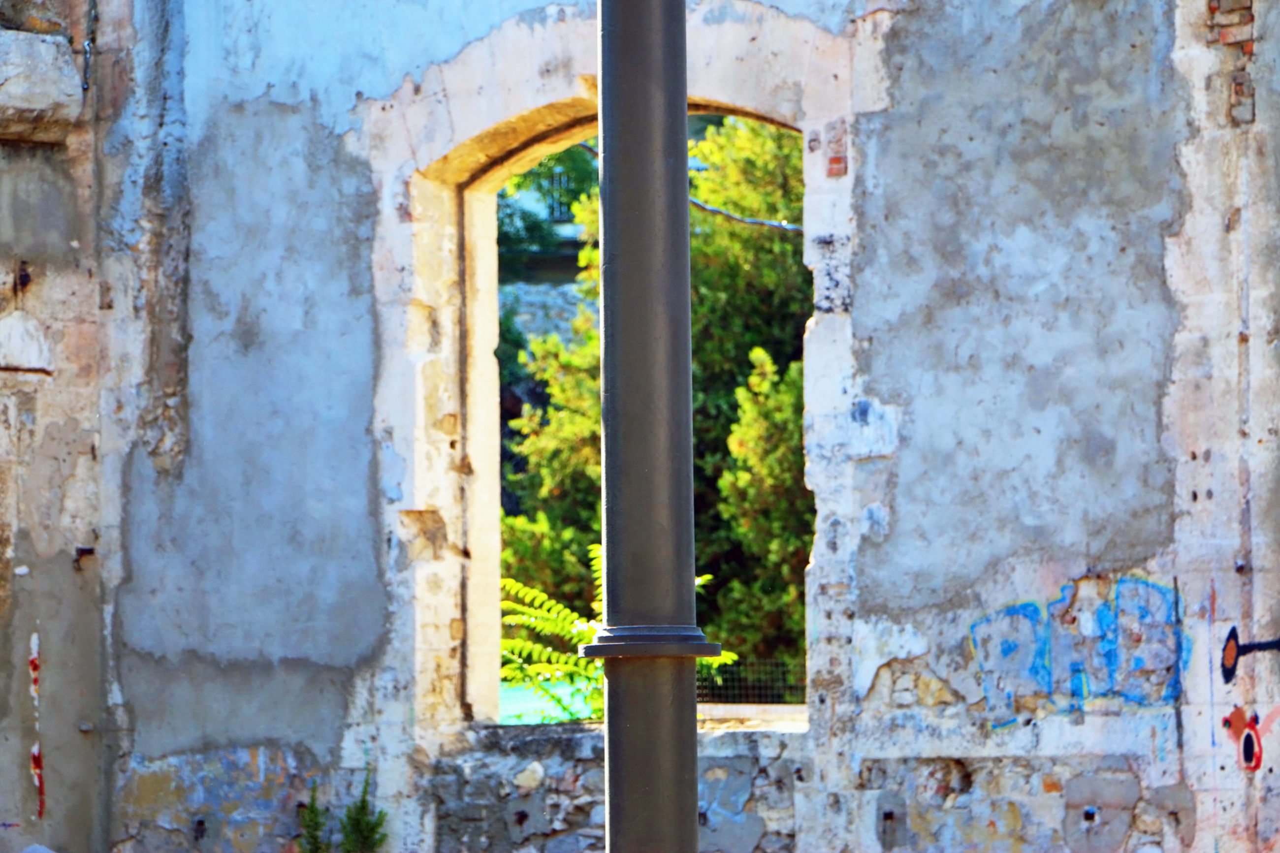 Pole against old abandoned building
