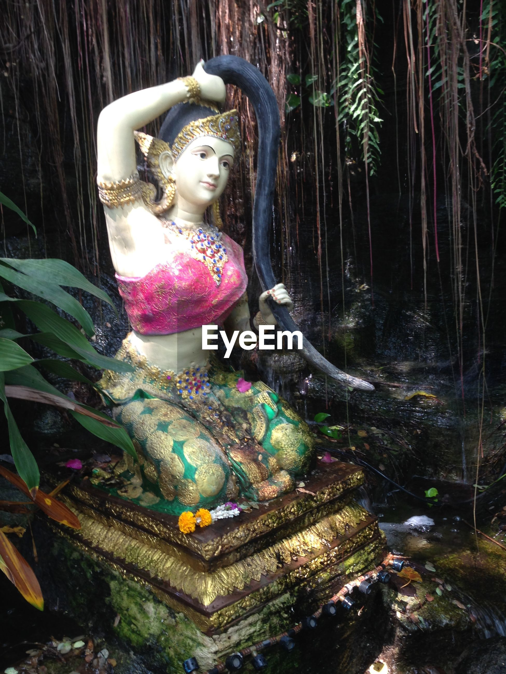 Religious female statue outside temple