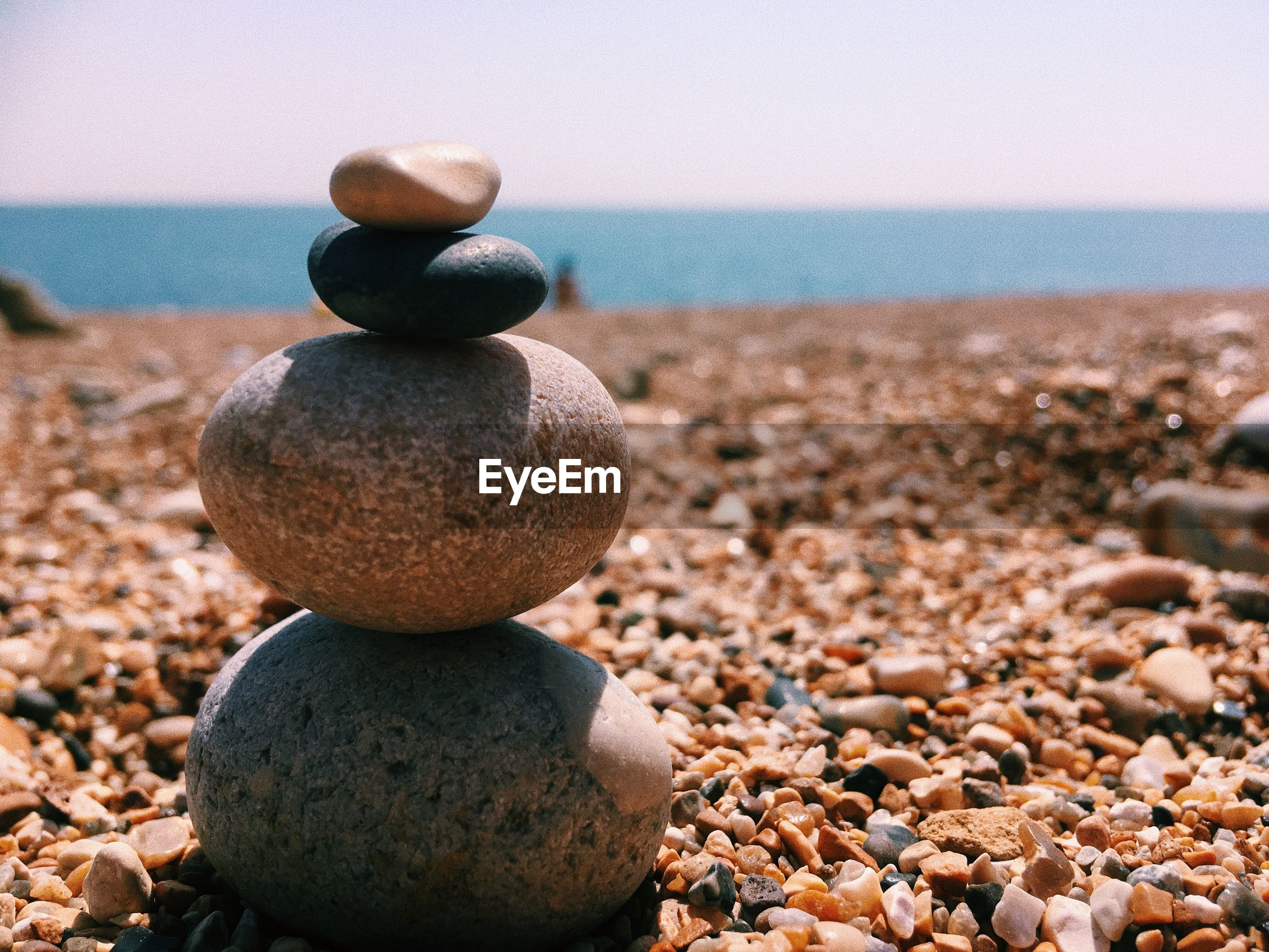 Stack of pebbles at beach during summer