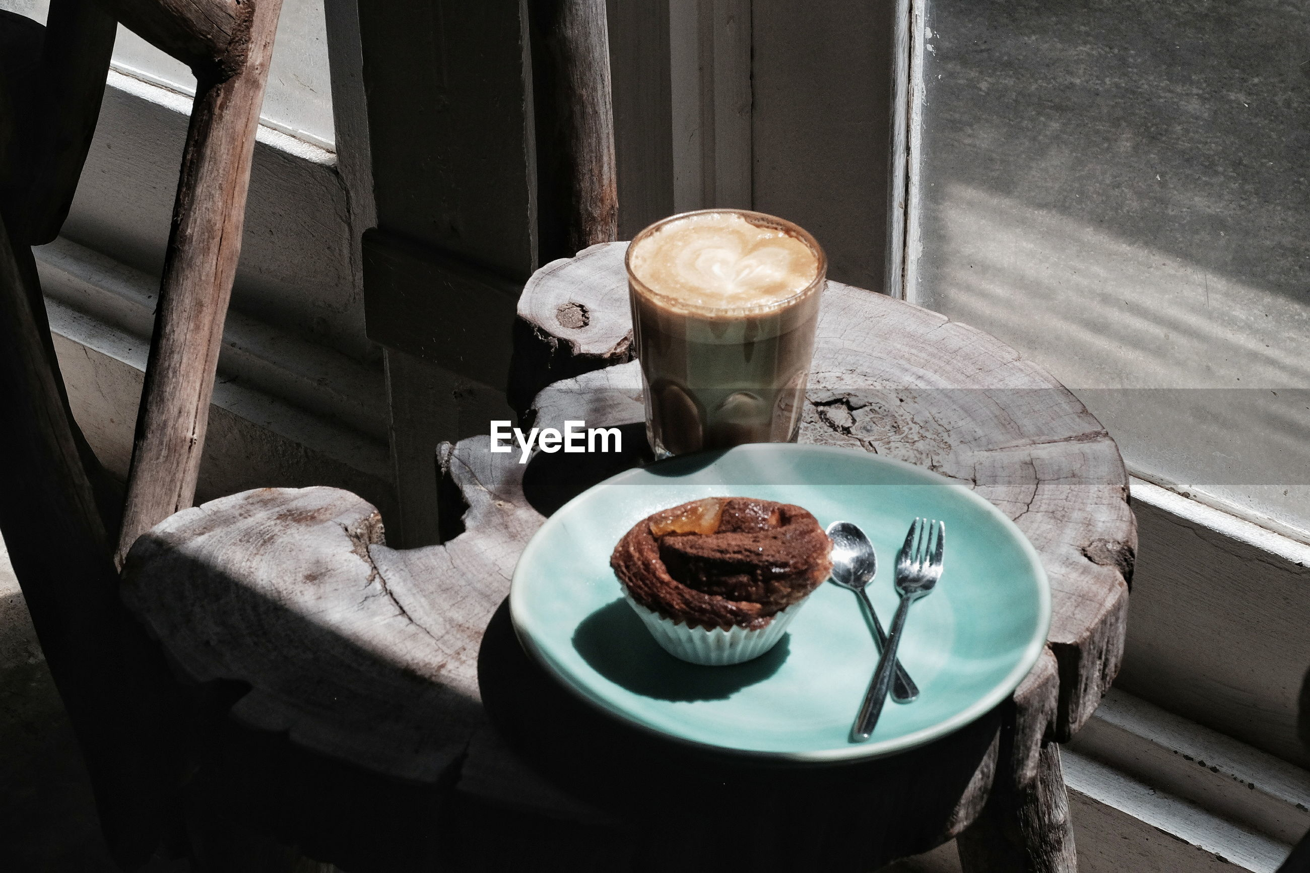 High angle view of dessert and coffee on tree stump
