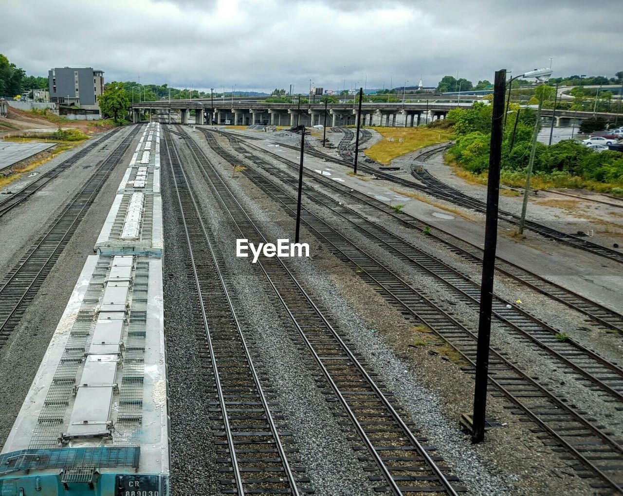 railroad track, transportation, rail transportation, sky, high angle view, public transportation, no people, day, train - vehicle, outdoors, built structure, building exterior, architecture