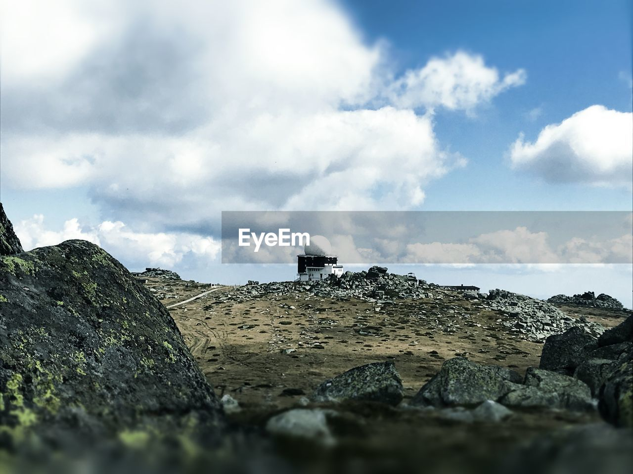sky, cloud - sky, rock, solid, built structure, nature, architecture, day, rock - object, history, no people, land, building exterior, the past, outdoors, environment, scenics - nature, building, beauty in nature, selective focus, ruined
