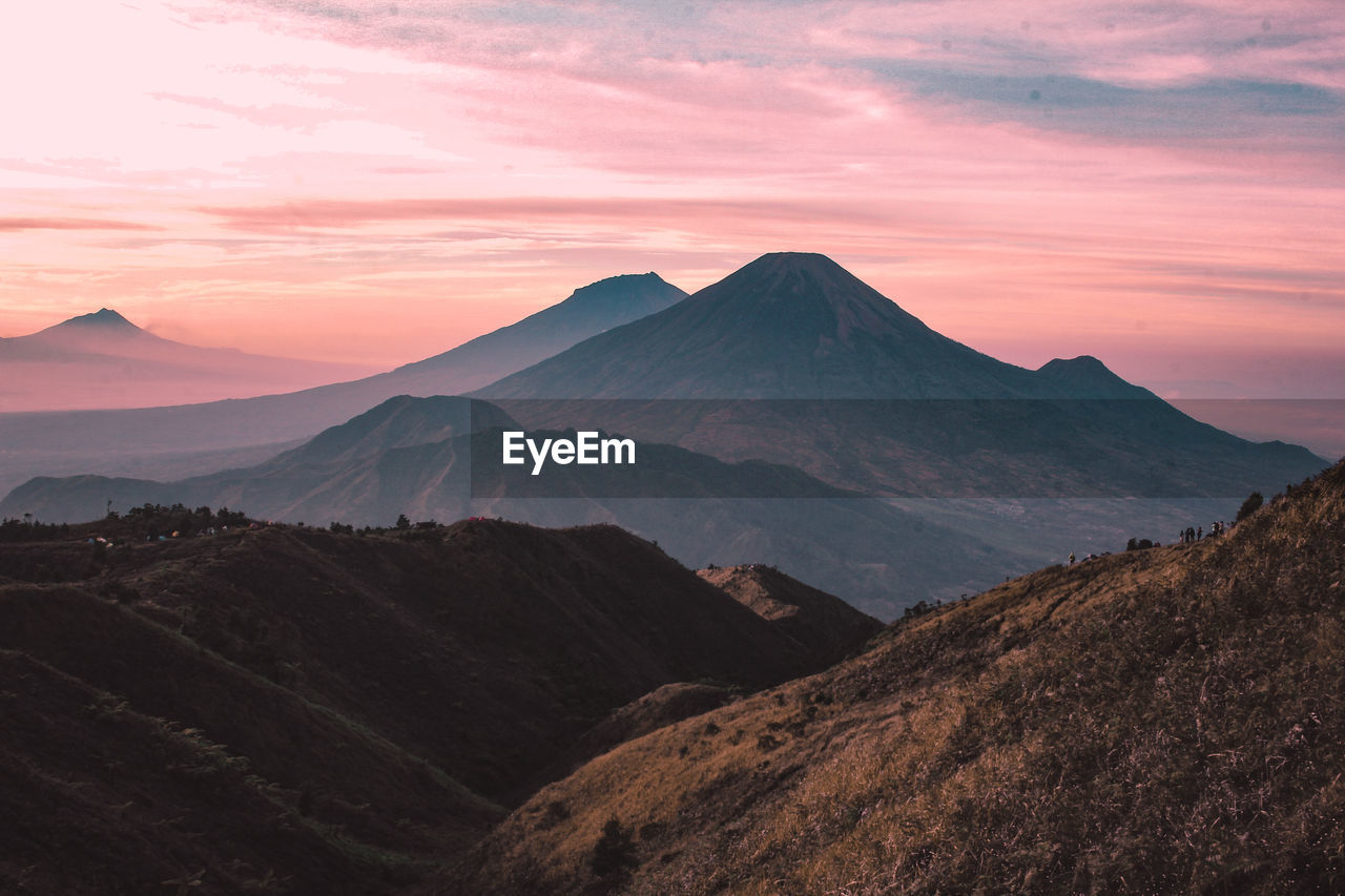 mountain, scenics - nature, sky, beauty in nature, tranquil scene, sunset, tranquility, landscape, environment, mountain range, non-urban scene, idyllic, cloud - sky, no people, land, nature, remote, physical geography, majestic, geology, outdoors, mountain peak, volcanic crater