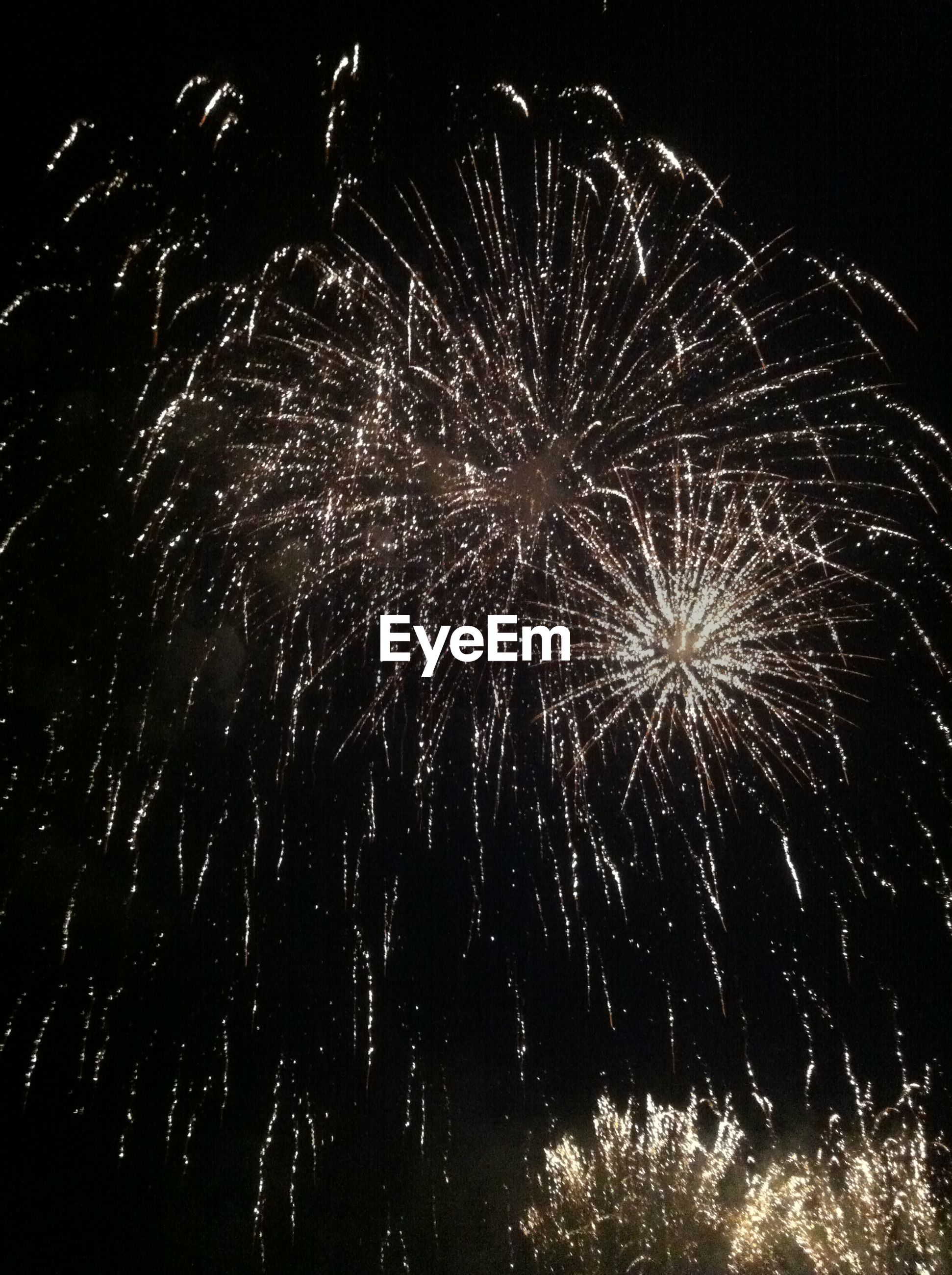 LOW ANGLE VIEW OF ILLUMINATED FIREWORKS