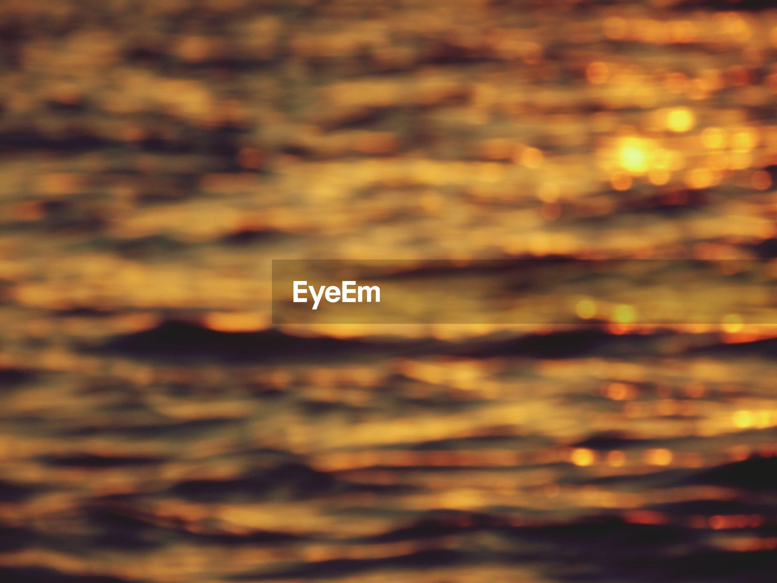 Defocused image of rippled sea during sunset