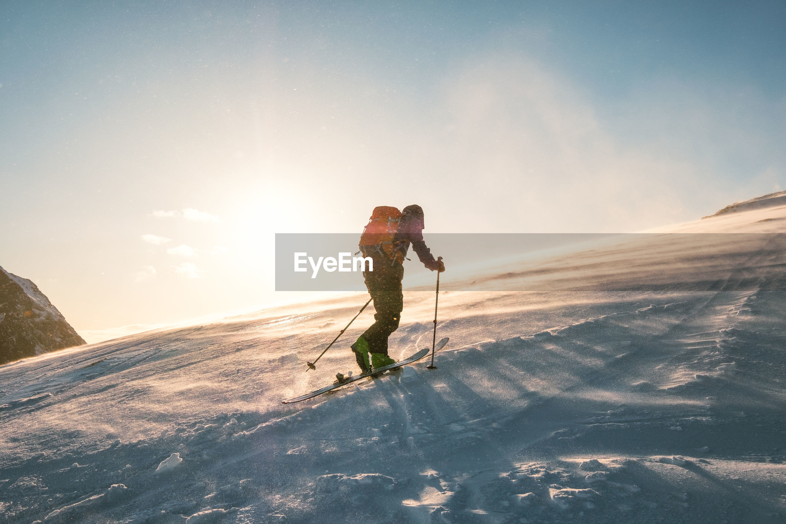 MAN SKIING ON MOUNTAIN DURING WINTER