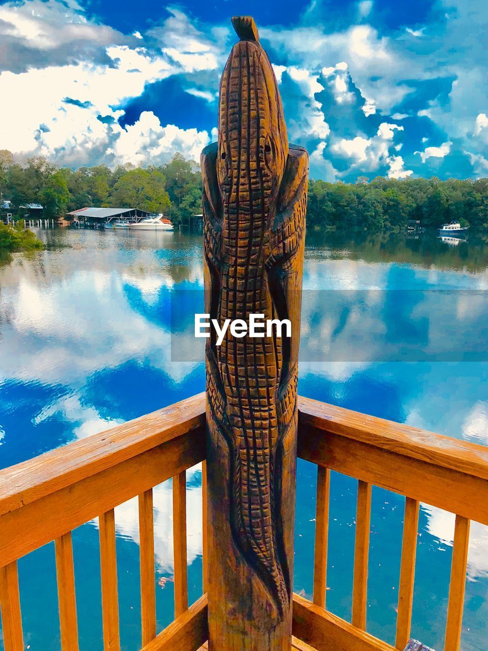 water, cloud - sky, sky, reflection, railing, nature, lake, wood - material, day, architecture, tranquility, no people, built structure, beauty in nature, scenics - nature, tranquil scene, outdoors, tree, turquoise colored
