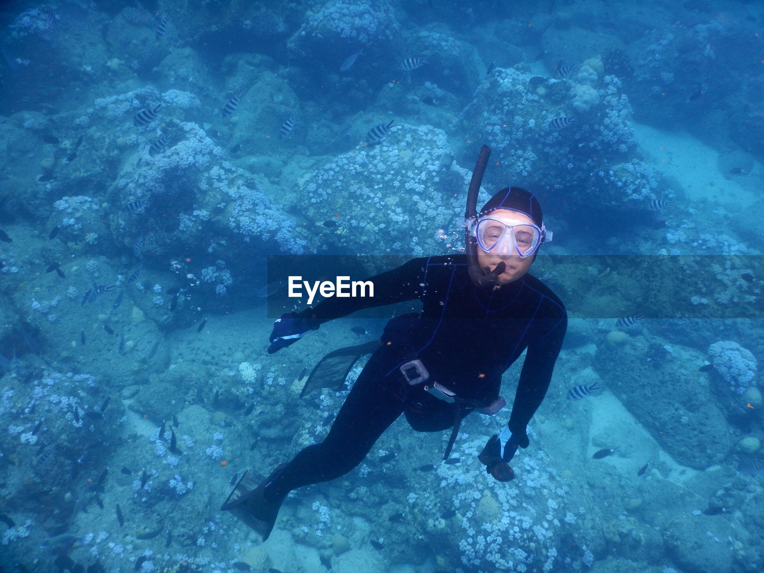 Portrait of woman scuba diving undersea