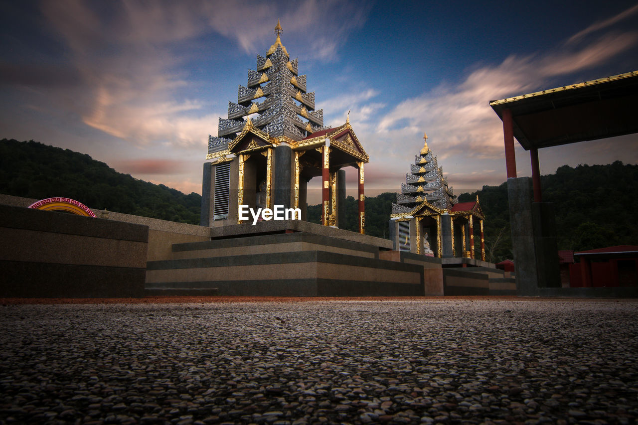 architecture, built structure, sky, cloud - sky, religion, spirituality, place of worship, belief, building exterior, building, nature, no people, history, the past, travel destinations, low angle view, outdoors, sunset, architectural column, surface level