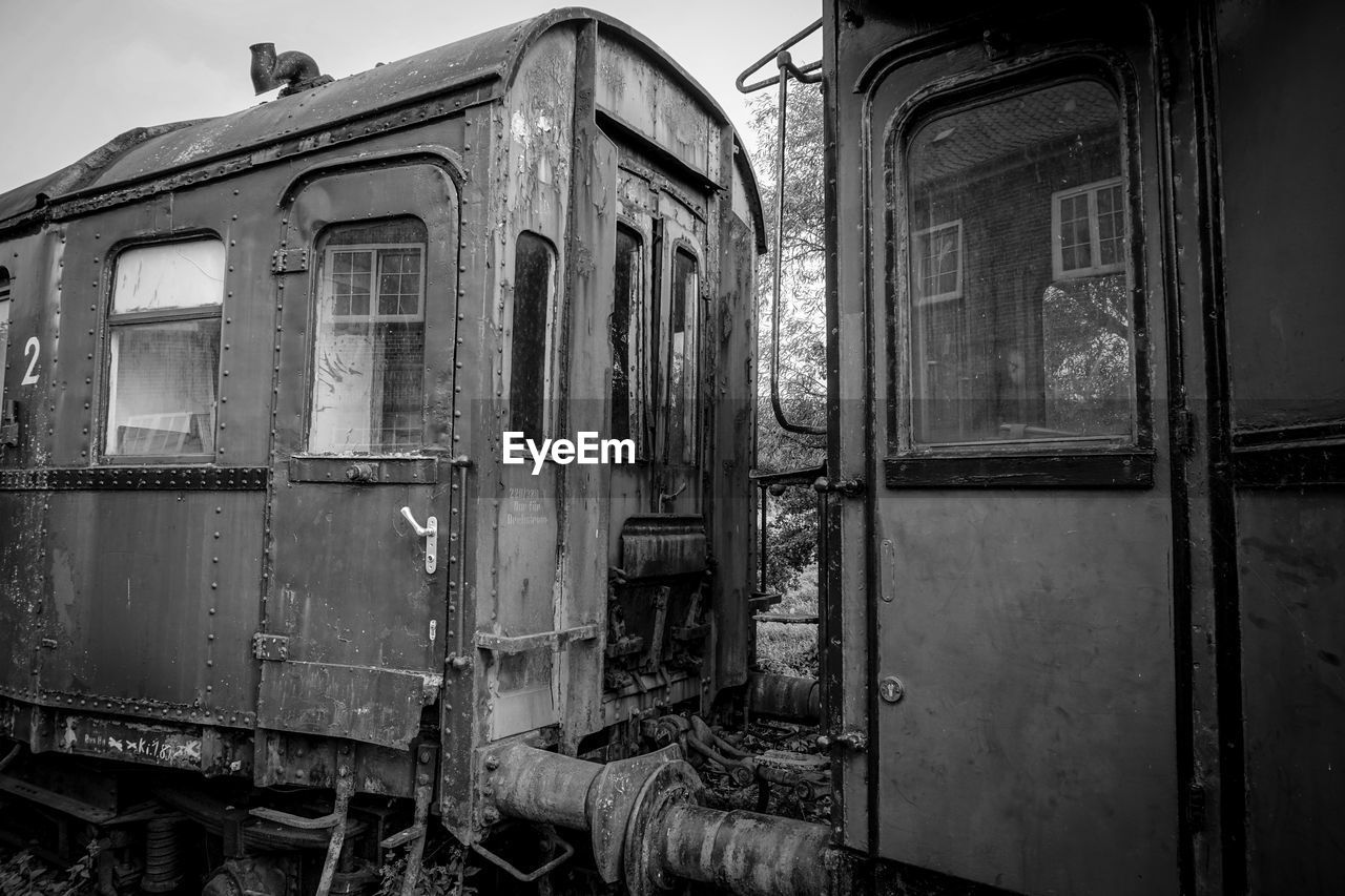 abandoned, obsolete, deterioration, decline, damaged, old, run-down, no people, architecture, day, mode of transportation, weathered, transportation, built structure, outdoors, window, nature, building exterior, bad condition, destruction, ruined, shunting yard
