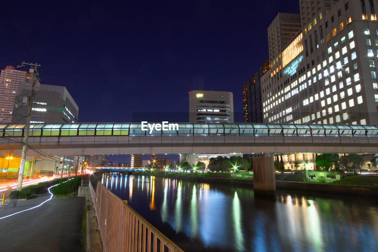 night, illuminated, architecture, built structure, building exterior, bridge - man made structure, city, modern, outdoors, transportation, road, skyscraper, no people, water, sky, clear sky, cityscape