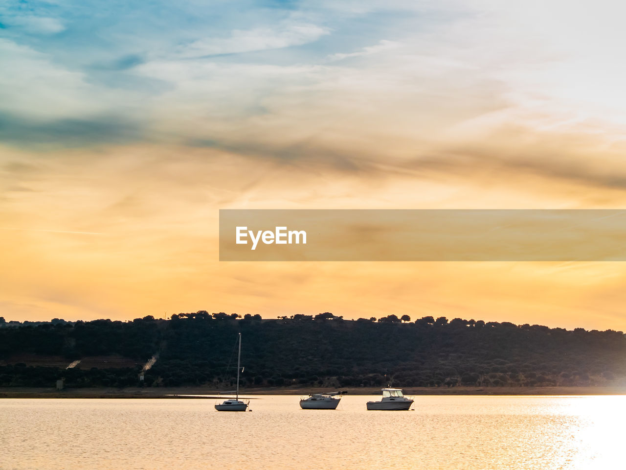 sky, cloud - sky, sunset, nature, scenics - nature, beauty in nature, tree, no people, water, tranquility, transportation, tranquil scene, plant, orange color, lake, mode of transportation, sport, outdoors, nautical vessel