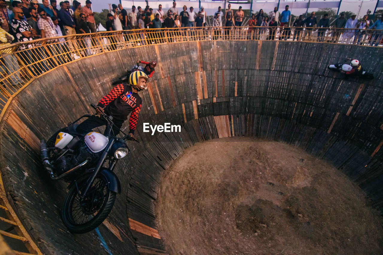 transportation, sport, motorcycle, high angle view, people, helmet, mode of transportation, adult, men, sports helmet, motion, day, headwear, group of people, nature, leisure activity, full length, adventure, architecture, land vehicle, crash helmet