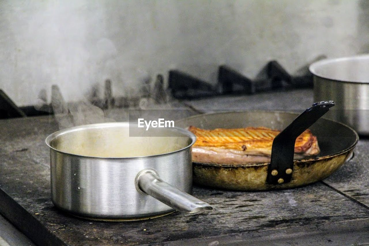 food and drink, indoors, no people, domestic kitchen, food, preparation, heat - temperature, flame, close-up, stove, kitchen, domestic room, day, healthy eating, freshness, camping stove
