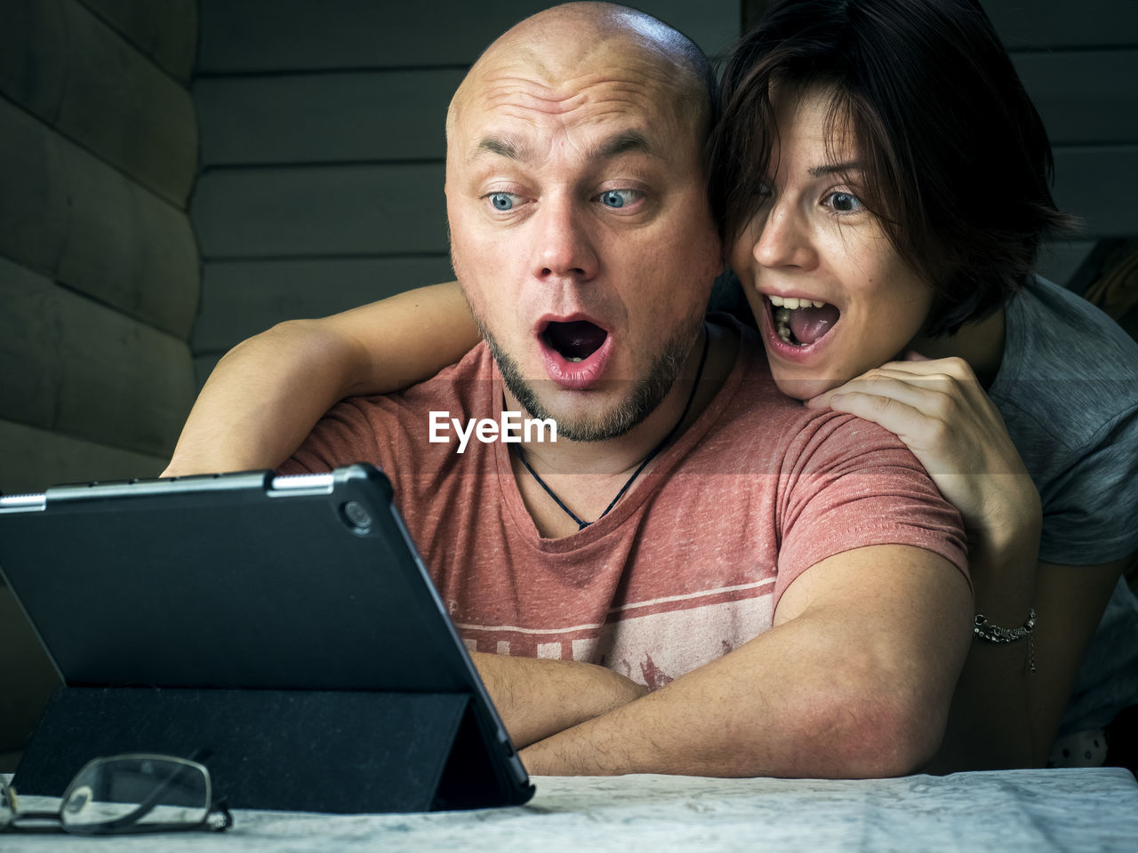 Friends looking at digital tablet
