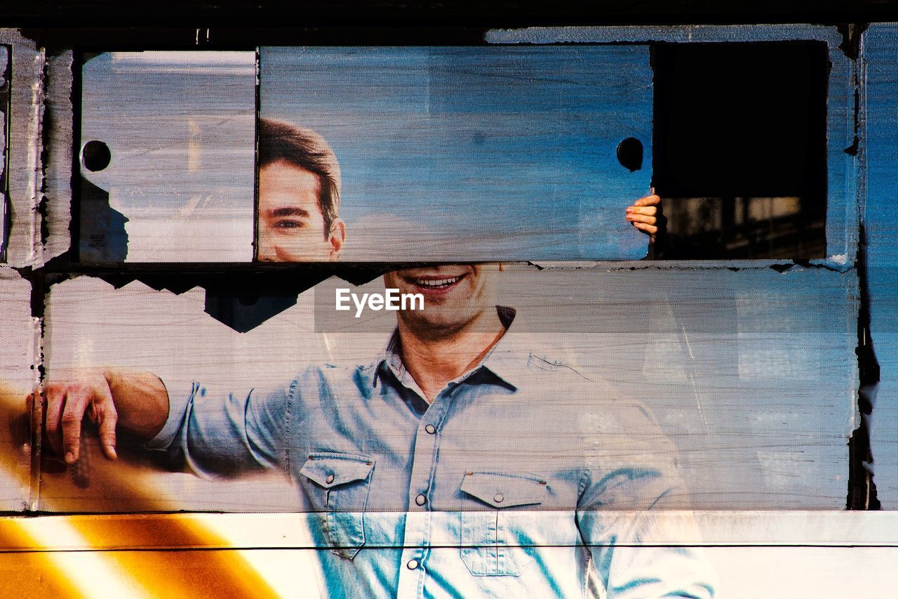 DIGITAL COMPOSITE IMAGE OF MAN WITH WINDOW