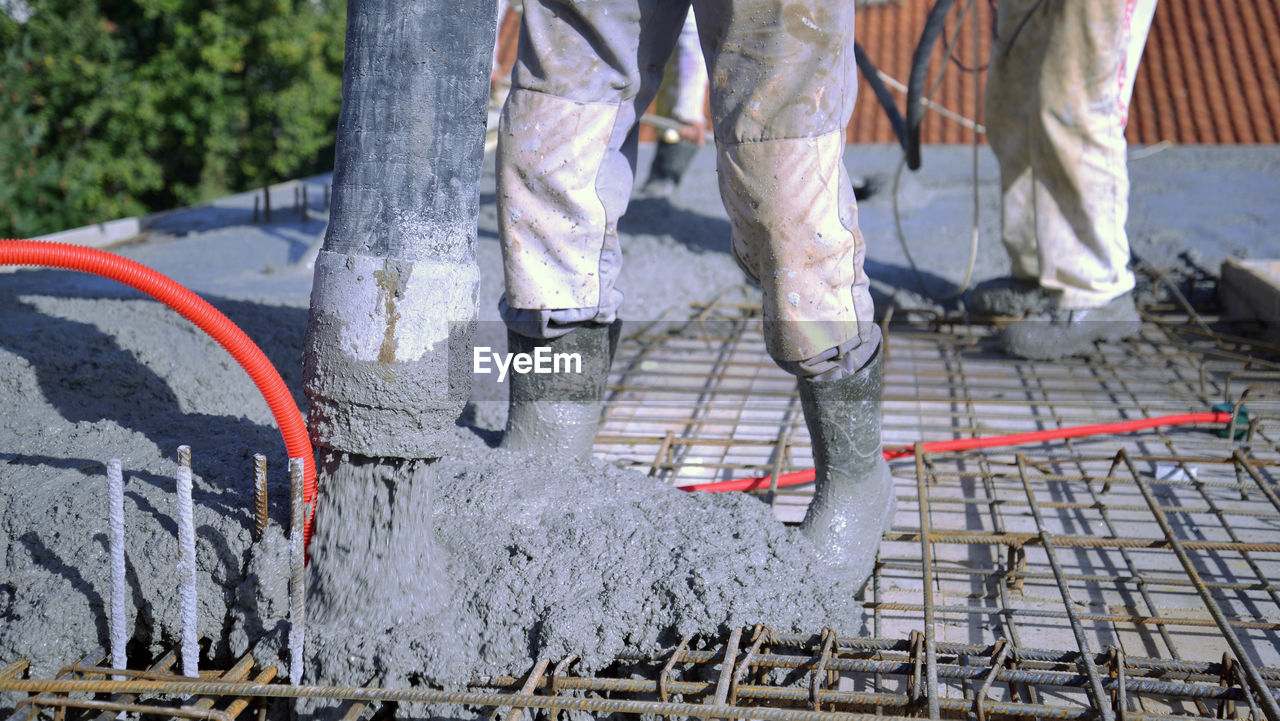 human body part, low section, day, working, people, outdoors, shoe, body part, motion, occupation, adult, human leg, nature, footpath, construction industry, real people, road construction, men, jeans, human limb, effort