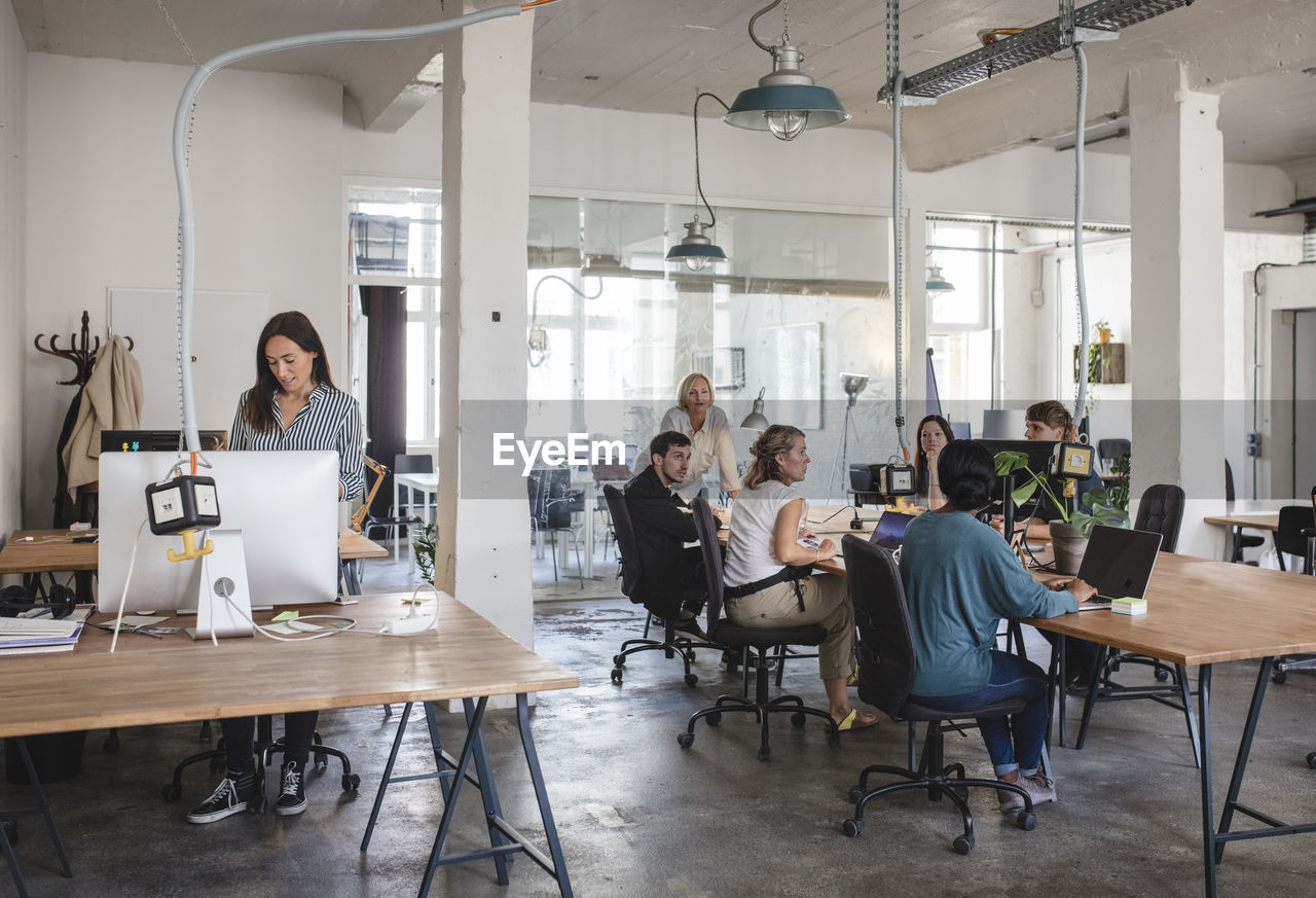 group of people, women, adult, men, sitting, real people, computer, communication, casual clothing, males, young adult, business, young women, indoors, laptop, table, office, technology, group, people, wireless technology, coworker, using laptop, new business