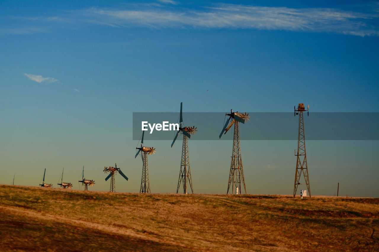 sky, environment, field, fuel and power generation, land, technology, landscape, alternative energy, cloud - sky, nature, renewable energy, environmental conservation, wind turbine, turbine, wind power, no people, blue, industry, rural scene, day, outdoors