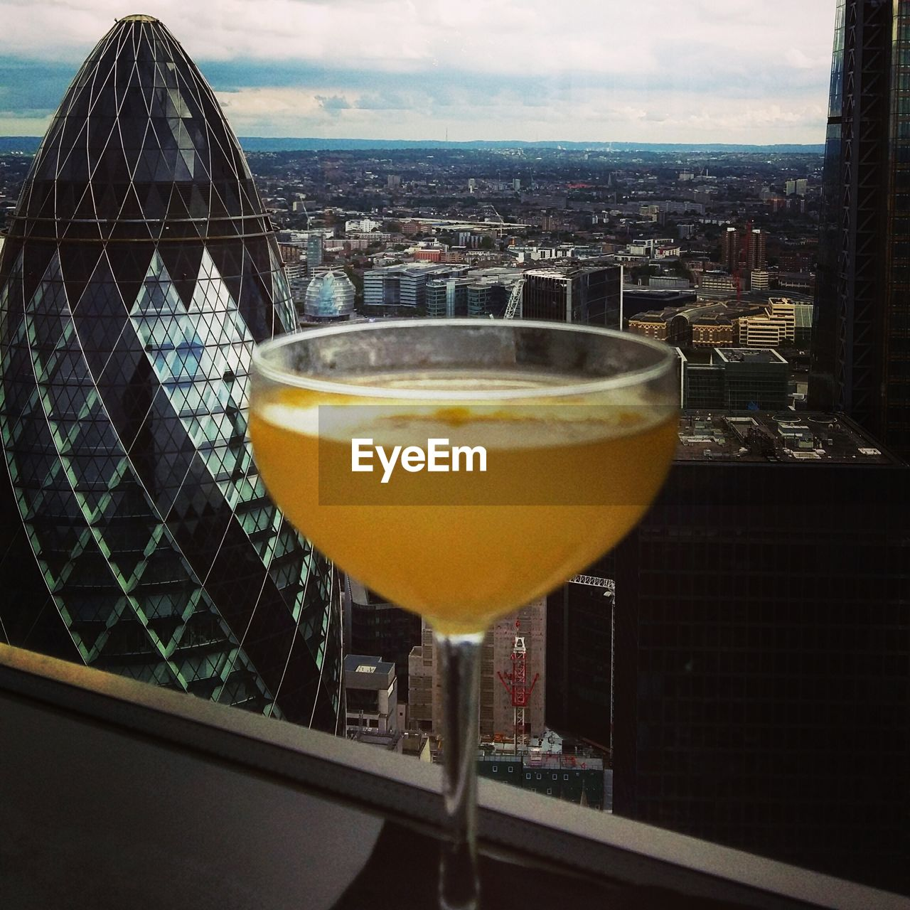 drink, refreshment, food and drink, alcohol, drinking glass, cocktail, no people, sky, freshness, outdoors, architecture, martini glass, close-up, day, cityscape, city, building exterior