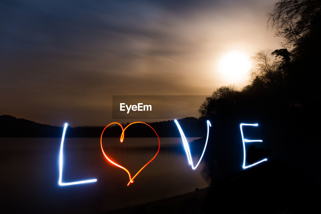 illuminated, sky, sunset, glowing, night, communication, nature, no people, orange color, lens flare, emotion, text, western script, positive emotion, light painting, love, heart shape, sign, long exposure, outdoors