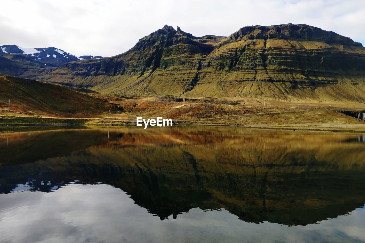 mountain, reflection, beauty in nature, water, sky, scenics - nature, tranquil scene, tranquility, environment, mountain range, lake, nature, waterfront, landscape, day, cloud - sky, no people, idyllic, non-urban scene, outdoors, mountain peak