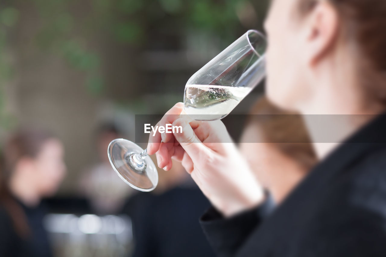 transparent, headshot, focus on foreground, glass, men, bubble, holding, one person, real people, day, vulnerability, males, blowing, fragility, refreshment, selective focus, drink, nature, lifestyles