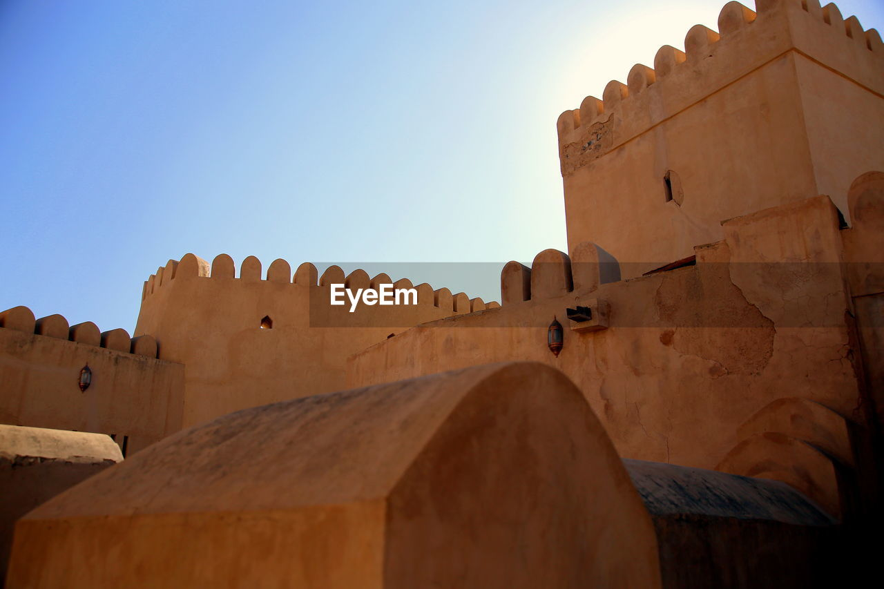 architecture, sky, built structure, low angle view, history, the past, nature, building exterior, no people, sunlight, day, fort, building, ancient, copy space, old, clear sky, travel, travel destinations, tourism, outdoors, roof tile
