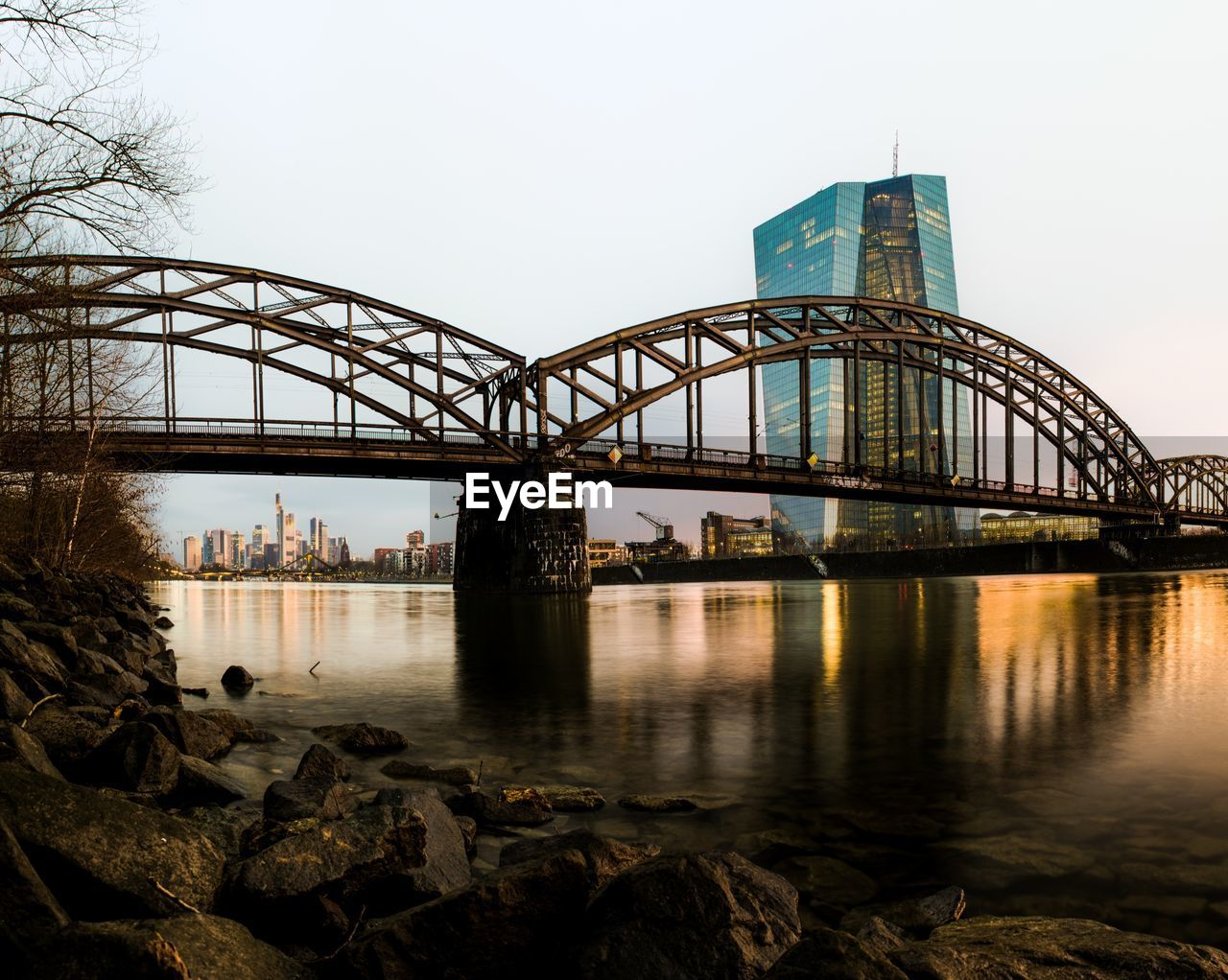 built structure, architecture, water, sky, building exterior, bridge, connection, reflection, bridge - man made structure, nature, river, city, clear sky, travel destinations, no people, day, transportation, waterfront, building, outdoors, modern, office building exterior, skyscraper