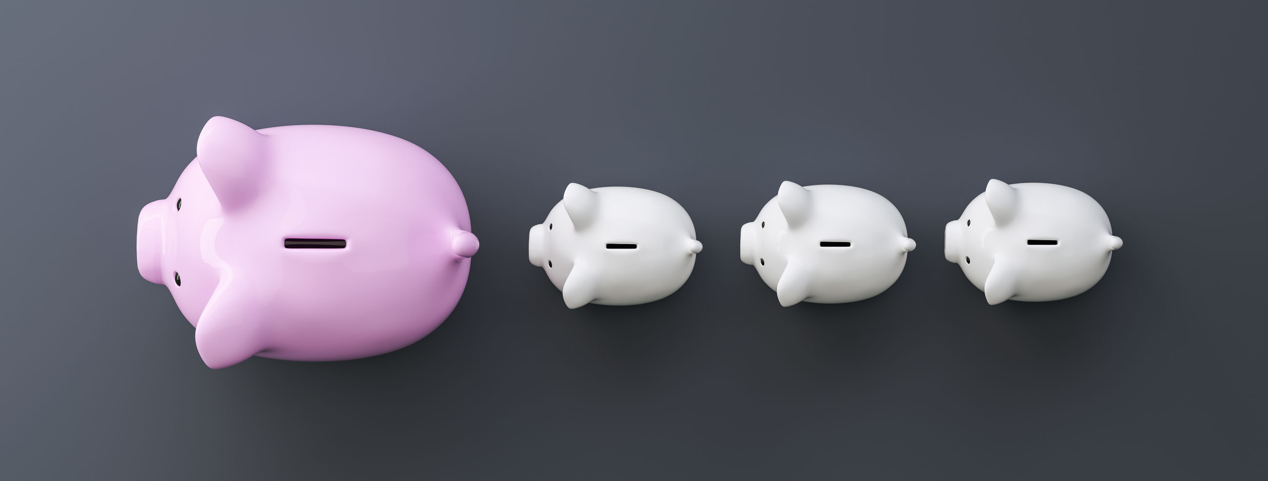 Directly above shot of piggy banks against gray background