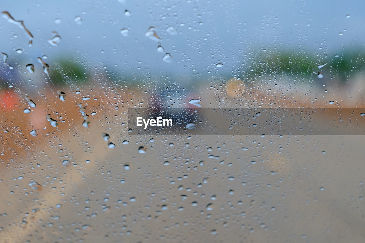 drop, water, wet, window, glass - material, transparent, indoors, no people, rain, close-up, full frame, nature, car, mode of transportation, motor vehicle, transportation, day, sky, raindrop, glass, rainy season