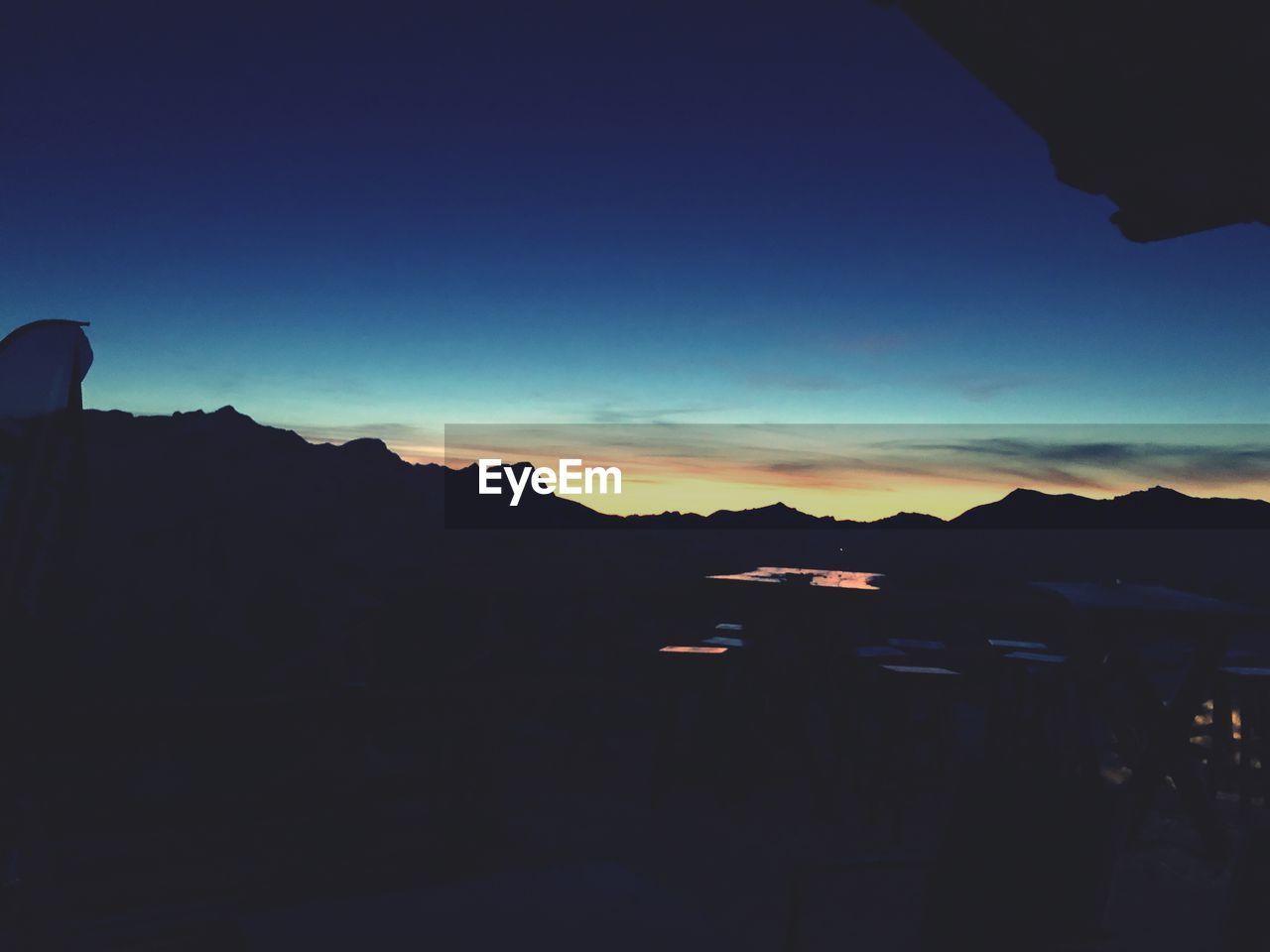 mountain, sky, silhouette, scenics - nature, beauty in nature, sunset, nature, tranquil scene, tranquility, mountain range, copy space, no people, outdoors, landscape, idyllic, environment, non-urban scene, cloud - sky, blue, dusk