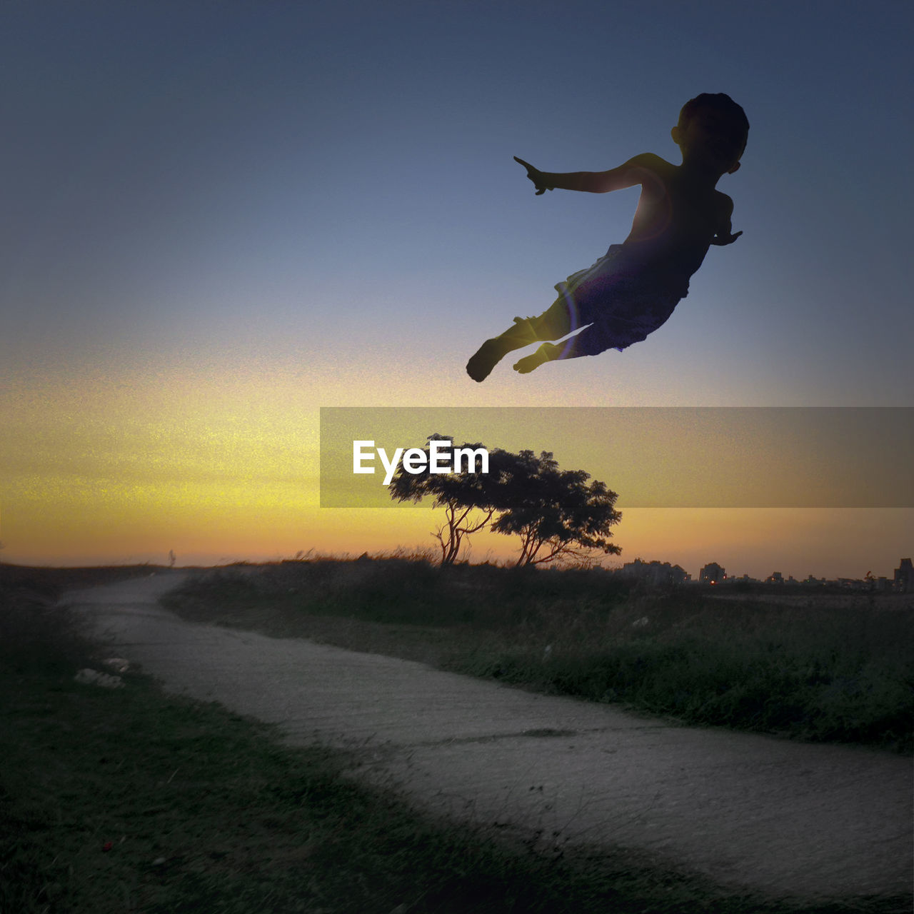 full length, sunset, jumping, energetic, one person, clear sky, nature, outdoors, mid-air, motion, real people, grass, sky, day, people