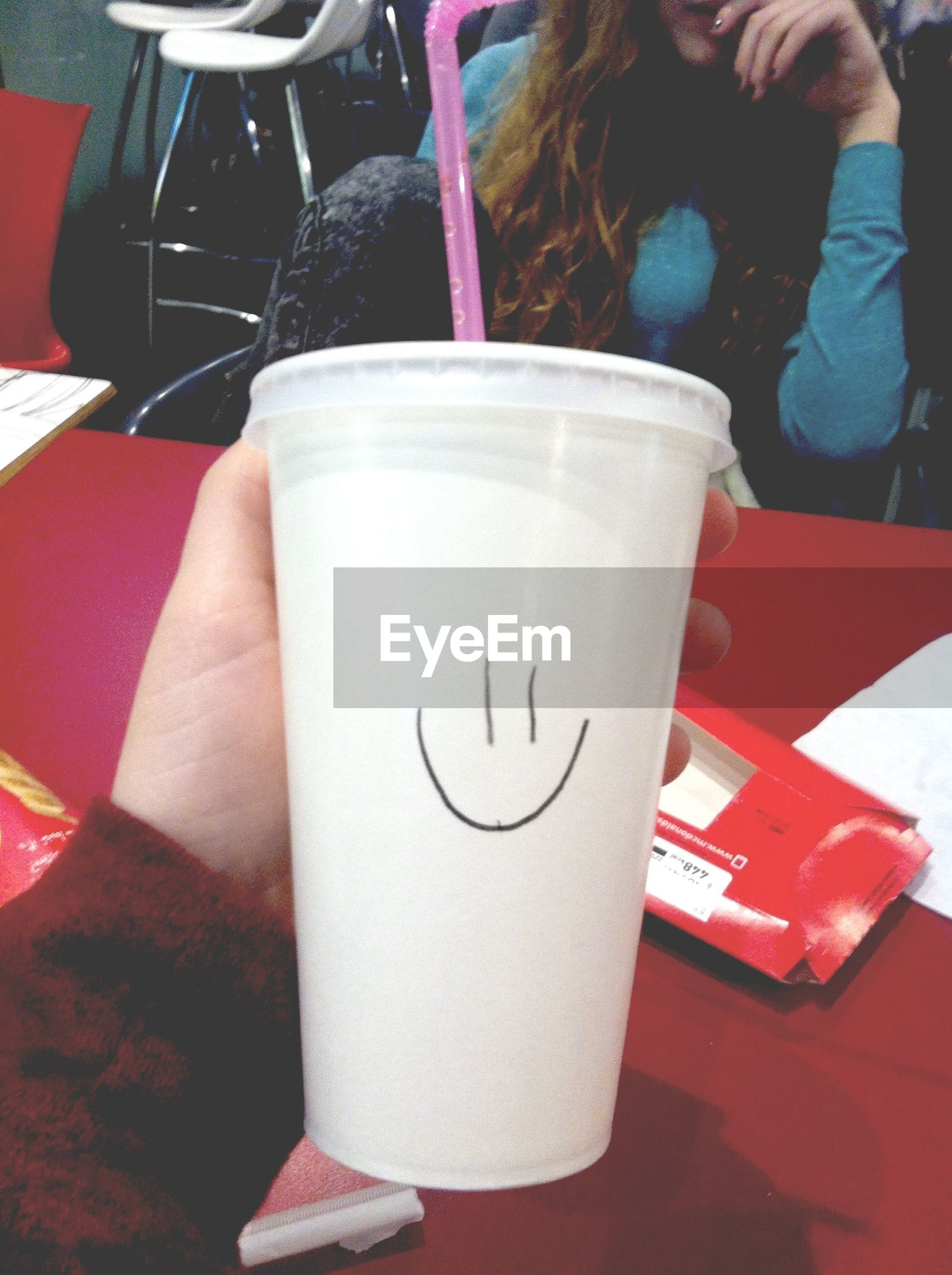 drink, food and drink, refreshment, table, holding, close-up, person, lifestyles, freshness, drinking glass, incidental people, men, unrecognizable person, coffee cup, restaurant, indoors