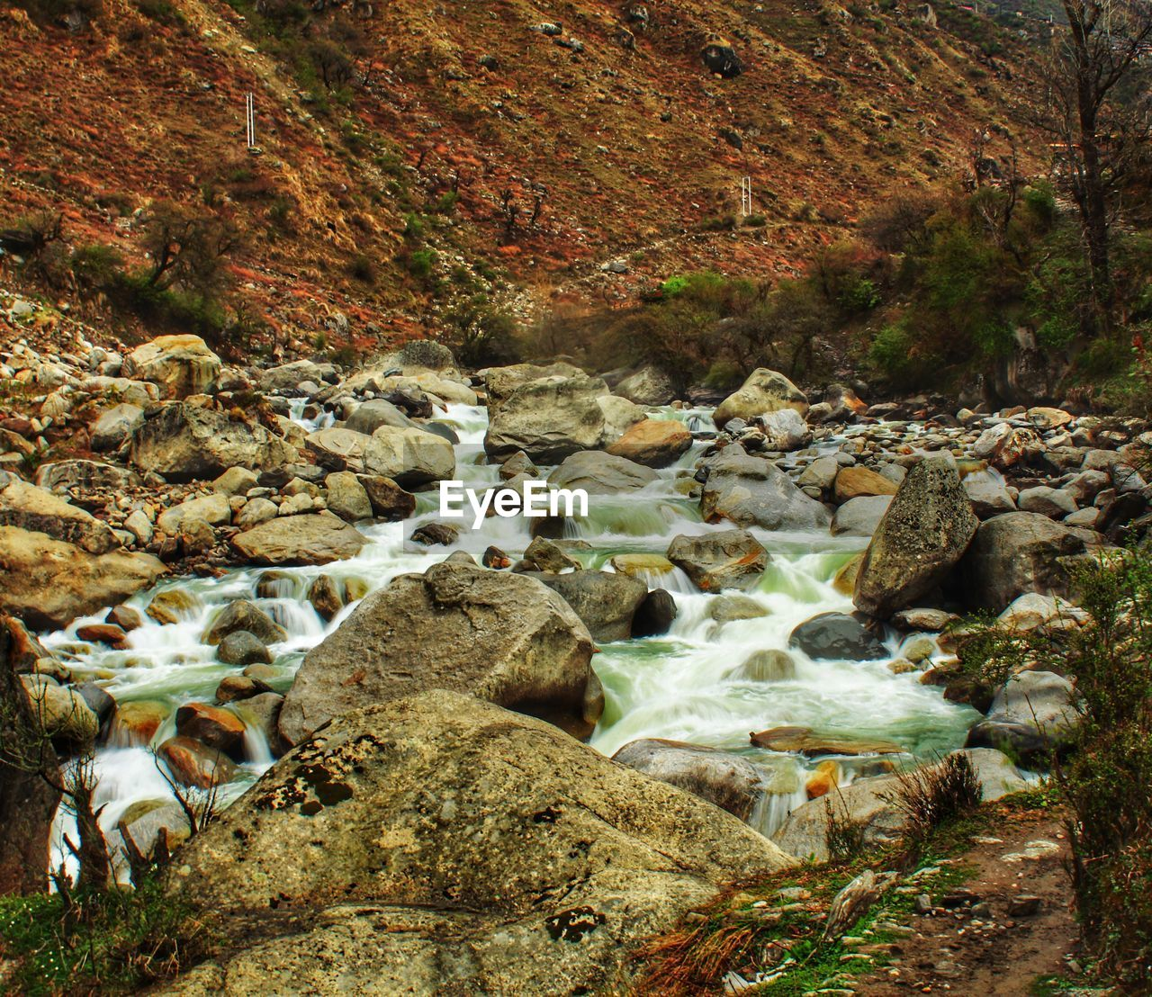 rock, rock - object, solid, water, scenics - nature, motion, nature, flowing water, beauty in nature, day, no people, blurred motion, land, long exposure, forest, tree, flowing, non-urban scene, river, stream - flowing water, outdoors, pebble