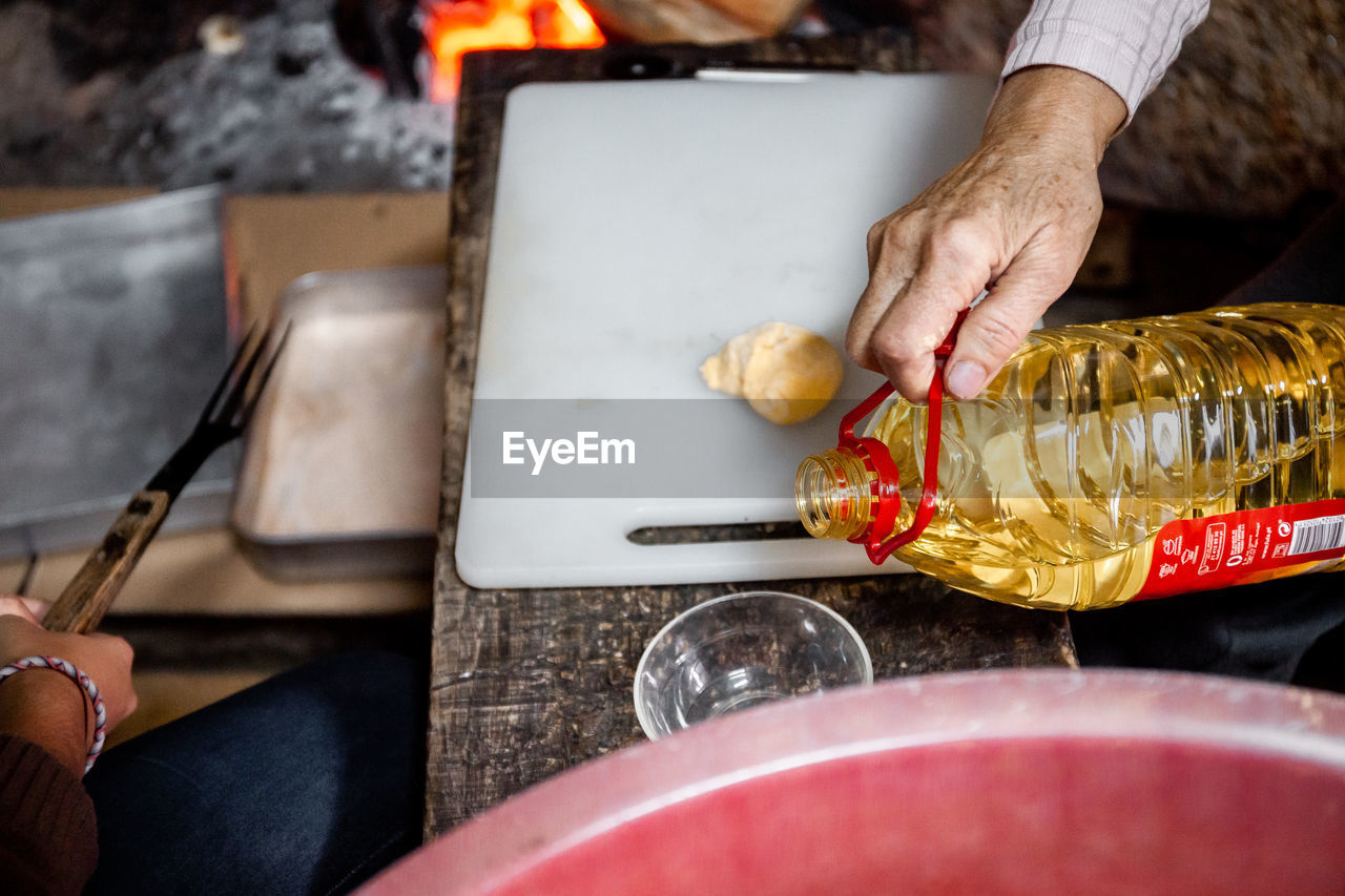Midsection of person preparing food