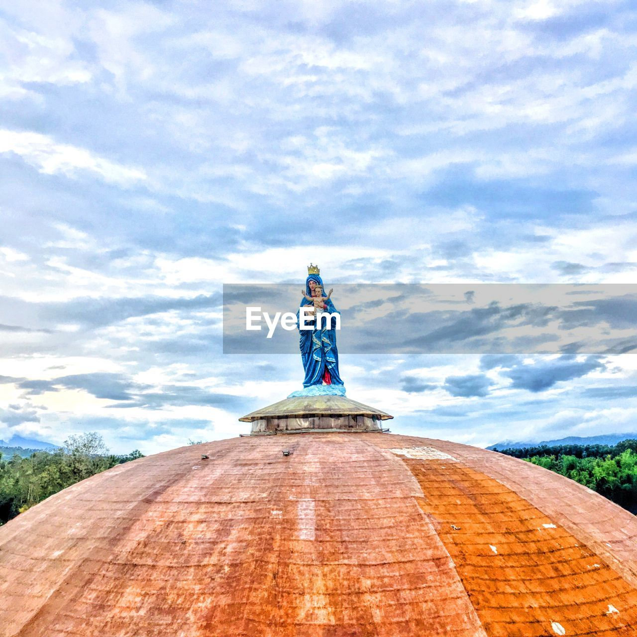 cloud - sky, sky, statue, human representation, sculpture, day, outdoors, low angle view, travel destinations, no people, architecture, nature