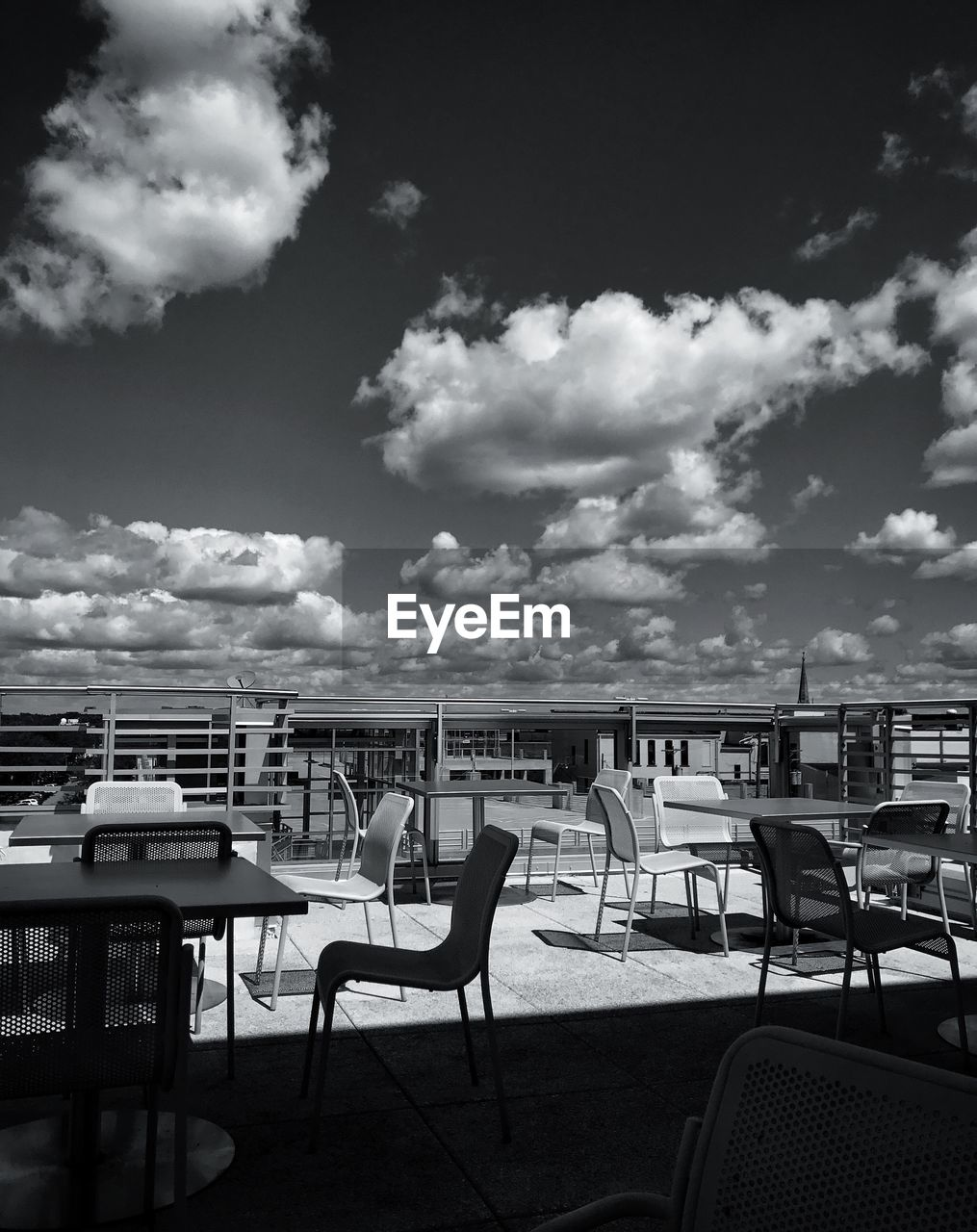 chair, table, outdoor cafe, sky, empty, restaurant, cafe, outdoors, no people, day, nature