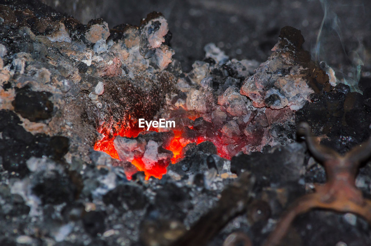 orange color, geology, rock - object, outdoors, no people, burning, close-up, lava, heat - temperature, ash, nature, day, beauty in nature