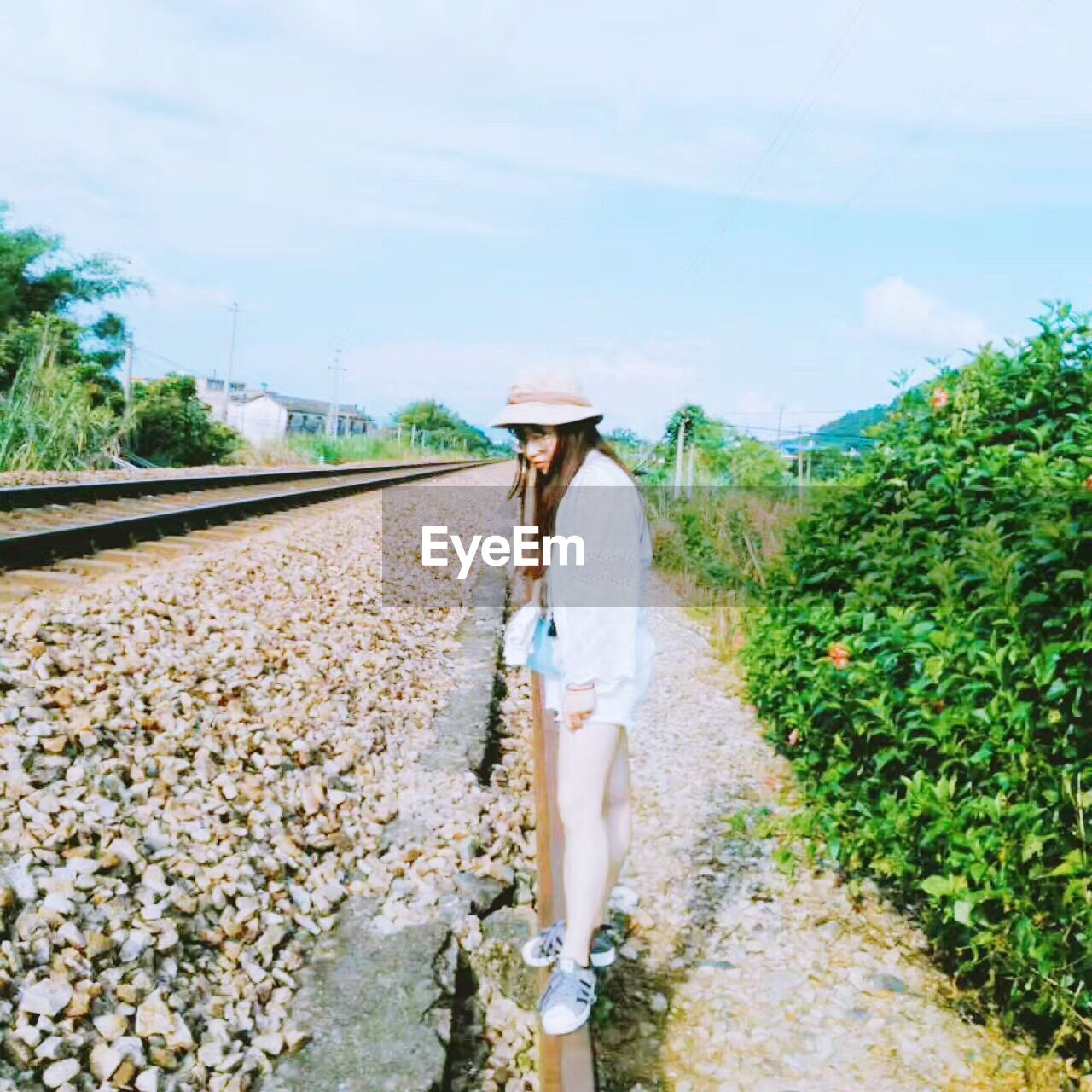 one woman only, only women, one person, adults only, casual clothing, hat, agriculture, adult, sun hat, young adult, one young woman only, women, people, day, young women, standing, full length, sky, outdoors, nature, freshness